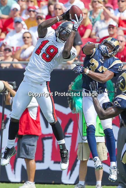 Tampa Bay Buccaneers wide receiver Sammie Stroughter (18) catches a pass for a first down as St. Louis Rams safety James Butler (37) defends. The Buccaneers defeated the Rams 18-17 in an NFL game  in Tampa, Fla, Sunday, October 25, 2010. (AP Photo/Margaret Bowles)