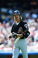 Randy Johnson of the Arizona Diamondbacks returns to the dugout after striking out during a 1999 season Major League Baseball game against the Los Angeles Dodgers at Dodger Stadium in Los Angeles, California. (Larry Goren/Four Seam Images)