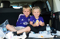Orlando, Florida - Saturday, April 23, 2016: A couple of young fans eat snack before an NWSL match between Orlando Pride and Houston Dash at the Orlando Citrus Bowl.