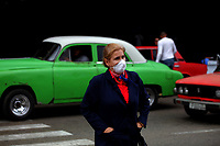 HAVANA, CUBA - March 12:  A woman wears face mask outside of  the International airport José Martí in Havana, Cuba, Thursday, March 12, 2020,  The World Health Organization declared a global pandemic as the coronavirus rapidly spreads across the world.(Photo by Eliana Aponte/VIEWpress)