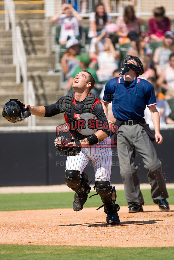 Catcher Zach Larson #30 of the Kannapolis Intimidators chases after a foul pop up at Fieldcrest Cannon Stadium June 2, 2009 in Kannapolis, North Carolina. (Photo by Brian Westerholt / Four Seam Images)