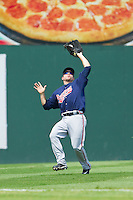 Gwinnett Braves left fielder Alden Carrithers (24) catches a fly ball during the International League game against the Charlotte Knights at Knights Stadium on July 28, 2013 in Fort Mill, South Carolina.  The Knights defeated the Braves 6-1.  (Brian Westerholt/Four Seam Images)