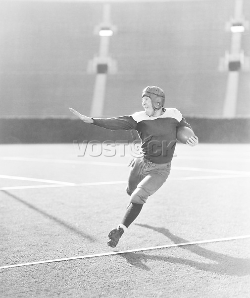 Football player running with ball