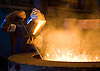 A worker removes impurities from a bath of molten iron at Kirsh Foundry, Inc., in Beaver Dam, Wisconsin. Photo by Kevin J. Miyazaki/Redux