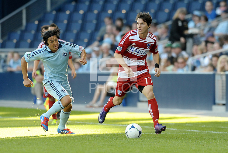Zac Loyd (17) FC Dallas defender goes past Roger Espinoza Sporting KC... Sporting Kansas City defeated FC Dallas 2-1 at LIVESTRONG Sporting Park, Kansas City, Kansas.
