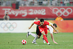10 August 2008: Zheng Zhi (CHN) (8) spins away from a Belgium player.  The men's Olympic soccer team of Belgium defeated the men's Olympic soccer team of China 2-0 at Shenyang Olympic Sports Center Wulihe Stadium in Shenyang, China in a Group C round-robin match in the Men's Olympic Football competition.