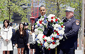 United States President Barack Obama walks with members of the NYPD and the FDNY holding a wreath as he visits Ground Zero, the site of the former Twin Towers, days after Osama Bin Laden was killed by U.S. Navy Seals almost 10 years after the terrorist attacks on the World Trade Center in New York on May 5, 2011. .Credit: John Angelillo / Pool via CNP
