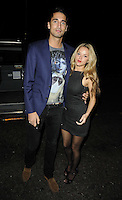 Hugo Taylor & Natalie Joel.attended the Kensington Club new boutique nightclub launch party, The Kensington Club, High Street Kensington, London, England,.20th July 2012..full length blue jacket blazer couple black trousers dress brown suede loafers .CAP/CAN.©Can Nguyen/Capital Pictures.