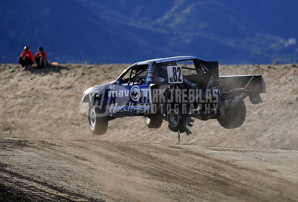 Dec. 19, 2009; Lake Elsinore, CA, USA; LOORRS unlimited lite driver Chris Brandt takes a jump with a blown rear tire during the Lucas Oil Challenge Cup at the Lake Elsinore Motorsports Complex. Mandatory Credit: Mark J. Rebilas-US PRESSWIRE