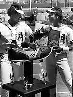 A's centerfielder Dwane Murphy, golden glove winner and Rickey Henderson with his stolden base trophy. Sept 11,1982 photo by Ron Riesterer