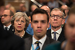 © Joel Goodman - 07973 332324 . 02/10/2016 . Birmingham , UK . THERESA MAY and PHILIP MAY sitting in the audience during the Chairman's speech during the first day of the Conservative Party Conference at the International Convention Centre in Birmingham . Photo credit : Joel Goodman