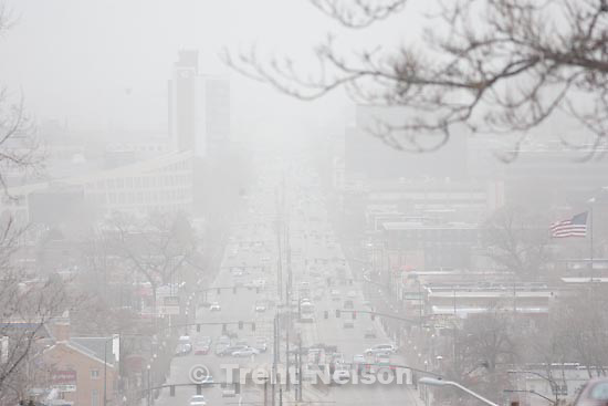 Trent Nelson     The Salt Lake Tribune.Salt Lake City - Looking down 4th south, Heavy winds filled the valley air with dust Tuesday, March 30, 2010.
