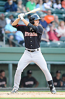 Outfielder Jacob Morris (24) of the Kannapolis Intimidators bats in a game against the Greenville Drive on Friday, April 11, 2014, at Fluor Field at the West End in Greenville, South Carolina. Greenville won, 13-2. (Tom Priddy/Four Seam Images)