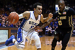 30 November 2014: Duke's Tyus Jones (5) and Army's Maxwell Lenox (0). The Duke University Blue Devils hosted the West Point Military Academy Army Black Knights at Cameron Indoor Stadium in Durham, North Carolina in a 2014-16 NCAA Men's Basketball Division I game. Duke won the game 93-73.