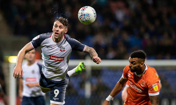 Bolton Wanderers' Daryl Murphy (left) competing with Blackpool's Curtis Tilt <br /> <br /> Photographer Andrew Kearns/CameraSport<br /> <br /> The EFL Sky Bet League One - Bolton Wanderers v Blackpool - Monday 7th October 2019 - University of Bolton Stadium - Bolton<br /> <br /> World Copyright © 2019 CameraSport. All rights reserved. 43 Linden Ave. Countesthorpe. Leicester. England. LE8 5PG - Tel: +44 (0) 116 277 4147 - admin@camerasport.com - www.camerasport.com