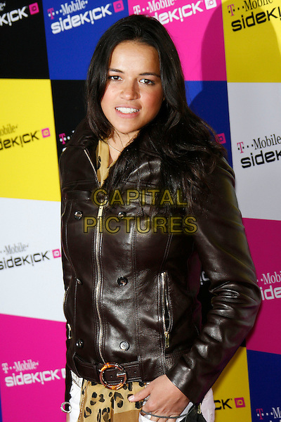 MICHELLE RODRIGUEZ.Attending the T-Mobile Sidekick iD Launch, .held at the T-Mobile Sidekick Lot,  Los Angeles, California, USA,13 April 2007..half length black leather jacket leopard print scarf belt.CAP/ADM/ZL.©Zach Lipp/AdMedia/Capital Pictures.