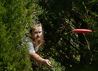 NWA Democrat-Gazette/BEN GOFF @NWABENGOFF<br /> Robert Cowan of Bella Vista putts from the bushes on Sunday Sept. 13, 2015 while playing a round at the Twin Creeks Disc Golf Course in Rogers.