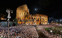 Fedeli affollano il Colosseo in occasione della Via Crucis presieduta dal Papa, a Roma, 3 aprile 2015.<br /> Faithful crowd the Colosseum on the occasion of Via Crucis (Way of the Cross) torchlight procession attended by the Pope in Rome, 3 April 2015.<br /> UPDATE IMAGES PRESS/Riccardo De Luca<br /> <br /> STRICTLY ONLY FOR EDITORIAL USE