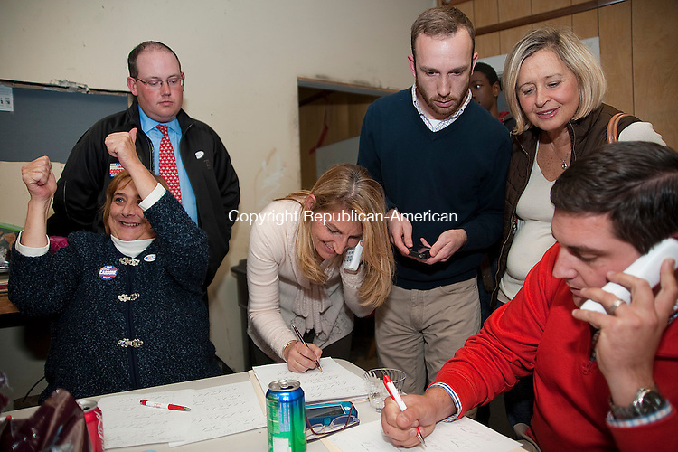 TORRINGTON- 110513JS15- Members of the Republican ticket and campaign, from left, Contible candidate Donna Isley; City Council candidate Gregg Cogswell; Republican Town Committee chairperson Wendy Traub; Tim Waldron; Rose Ponte and former mayor Ryan J. Bingham get results as the polls close Tuesday at Republican election headquarters in Torrington. <br /> Jim Shannon Republican-American