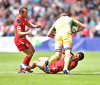 Australia's Tom Cusack is tackled by Wales's Luke Morgan<br /> <br /> Australia Vs Wales - Men's quarter-final<br /> <br /> Photographer Chris Vaughan/CameraSport<br /> <br /> 20th Commonwealth Games - Day 4 - Sunday 27th July 2014 - Rugby Sevens - Ibrox Stadium - Glasgow - UK<br /> <br /> © CameraSport - 43 Linden Ave. Countesthorpe. Leicester. England. LE8 5PG - Tel: +44 (0) 116 277 4147 - admin@camerasport.com - www.camerasport.com