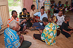 Viti Levu, Fiji; the men of the village play musical instruments during a cultural tour