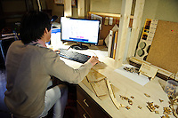 Designer Brandon Hur making a wooden notepad holder, FabLab, Kamakura, Kanagawa Pref, Japan, December 9, 2011.