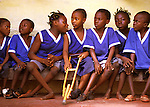 POLIO AFFECTED CHILDREN IN THE SCHOOLYARD OF THE SHESHIRE HOME FOR HANDICAPPED CHILDREN IN FREETOWN, SIERRA LEONE. (Photo by JEAN-MARC GIBOUX)