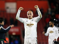 Pictured: Jonjo Shelvey of Swansea thanks away supporters after the end of the game Sunday 01 February 2015<br />