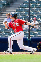Charlie Culberson #6 of the Richmond Flying Squirrels follows through on his swing against the Harrisburg Senators at The Diamond on July 22, 2011 in Richmond, Virginia.  The Squirrels defeated the Senators 5-1.   (Brian Westerholt / Four Seam Images)