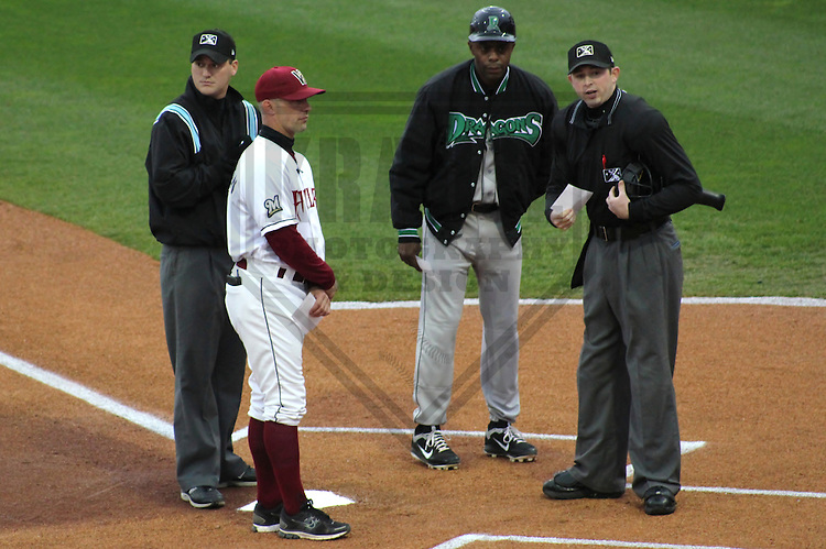 APPLETON - April 2012: Delino DeShields (90) of the Dayton Dragons, Class-A affiliate of the Cincinnati Reds and Matt Erickson (8) of the Wisconsin Timber Rattlers, Class-A affiliate of the Milwaukee Brewers exchange lineup cards prior to a game on April 25, 2012 at Time Warner Cable Field at Fox Cities Stadium in Appleton, Wisconsin. (Photo by Brad Krause).