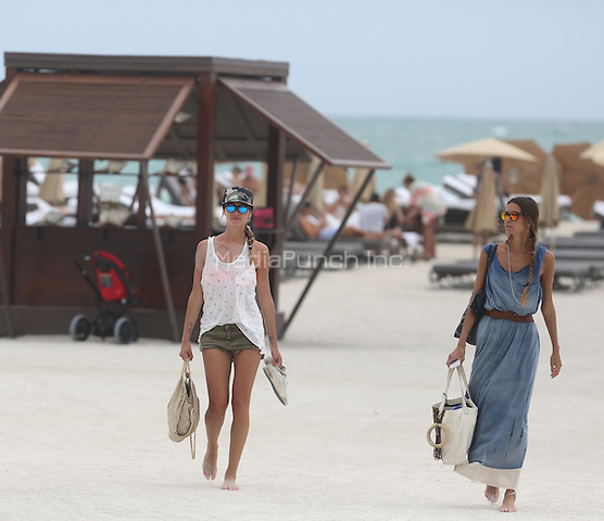 ***EXCLUSIVE*** APRIL 28 2013. Melissa Satta shows her slim figure on the beach Mandatory Credit: XIM/KDNPIX/MediaPunch Inc. ***EXCLUSIVE-Rates Must Be Negotiated Before Use***