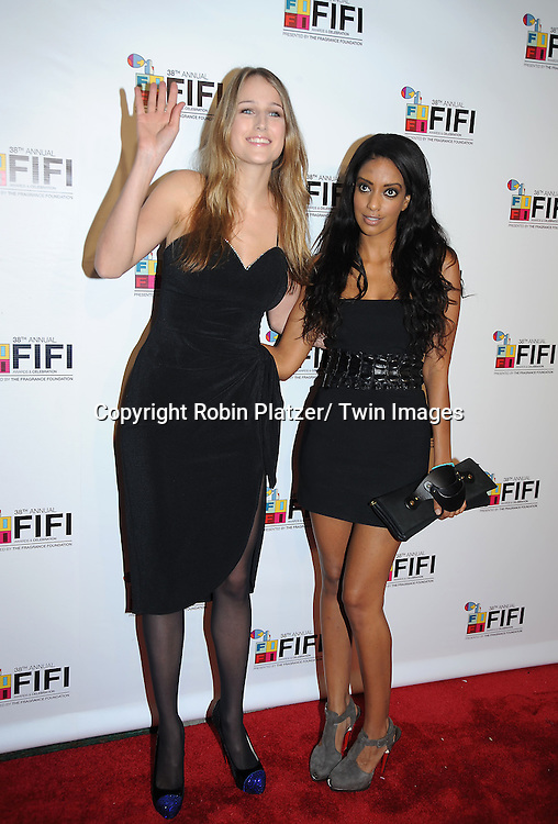 Leelee Sobieski in Vintage black dress and friend Azie Tesfai attending The 2010 FiFi Awards and Celebration on June 10, 2010 at The Downtown Armory in New York City