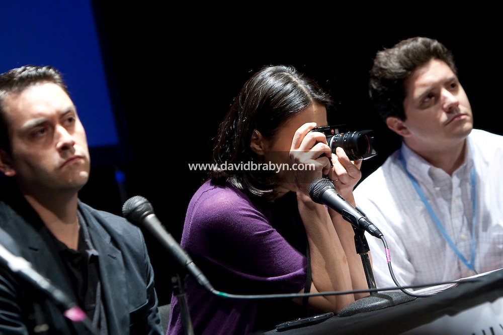 Television journalist Ann Curry (@anncurry, C) photographs the audience with her Leica M8 from her panelist's seat during the 140 Character conference in New York City, USA, 16 June 2009.