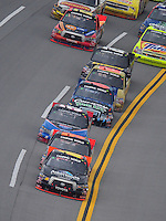 Oct. 31, 2009; Talladega, AL, USA; NASCAR Camping World Truck Series driver Brian Scott leads the field during the Mountain Dew 250 at the Talladega Superspeedway. Mandatory Credit: Mark J. Rebilas-