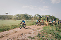 peloton conquering the gravel sectors<br /> <br /> Antwerp Port Epic 2018 (formerly &quot;Schaal Sels&quot;)<br /> One Day Race:  Antwerp &gt; Antwerp (207 km; of which 32km are cobbles &amp; 30km is gravel/off-road!)