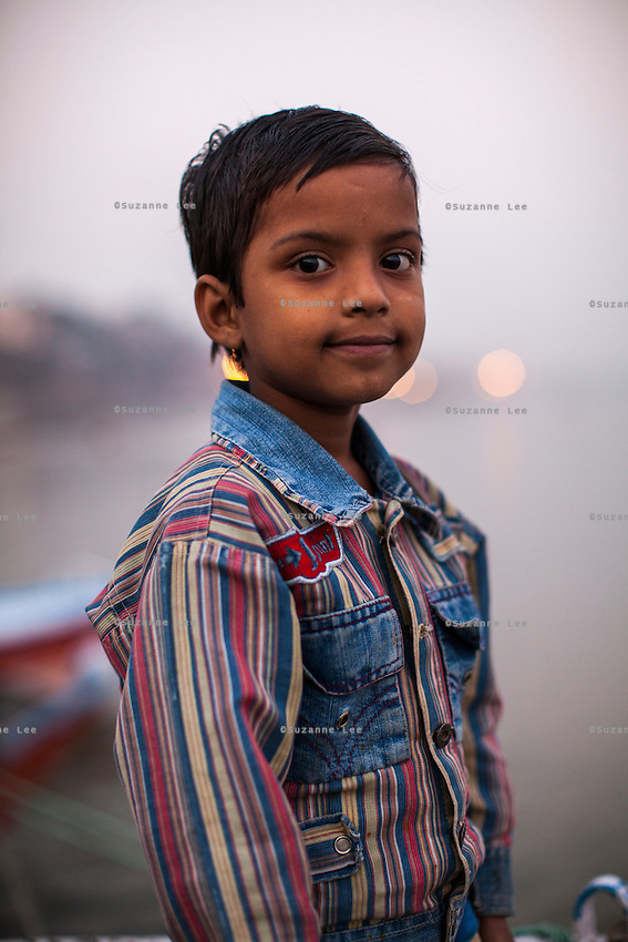 Piyu, 7, poses for a portrait on the Boat School Guria runs on the holy Ganges River, in Varanasi, Uttar Pradesh, India on 19 November 2013. The school, accommodating almost 50 children, aims to take the boatmen's children away from working in the tourist areas where they are exposed to trafficking and sexual abuse.