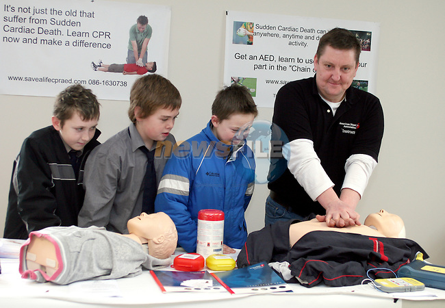 Martin Walsh, Heart Saver Instructor from Savealife CPR and Defib Training gives Michael Walsh, Dale Finnegan Byrne, James Kierans and Martin Walsh from St. Josephs CBS Sundays Gate a CPR Demonstration at the Barbican Parish Centre Open Day...Photo NEWSFILE/Jenny Matthews.(Photo credit should read Jenny Matthews/NEWSFILE)....This Picture has been sent you under the condtions enclosed by:.Newsfile Ltd..The Studio,.Millmount Abbey,.Drogheda,.Co Meath..Ireland..Tel: +353(0)41-9871240.Fax: +353(0)41-9871260.GSM: +353(0)86-2500958.email: pictures@newsfile.ie.www.newsfile.ie.FTP: 193.120.102.198.