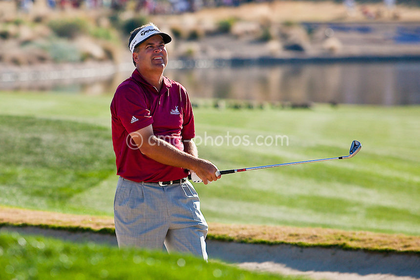 Jan 31, 2009; Scottsdale, AZ, USA; Kenny Perry (USA) hits out of a fairway bunker on the 18th hole during the third round of the FBR Open at the TPC Scottsdale.  Mandatory Credit: Chris Morrison-US PRESSWIRE