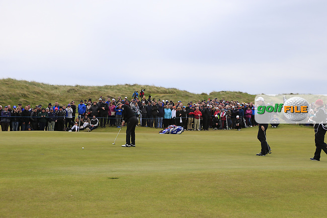 Luke Donald (ENG) takes his putt on the 1st green during Saturday's Round 3 of the 2015 Dubai Duty Free Irish Open, Royal County Down Golf Club, Newcastle Co Down, Northern Ireland 5/30/2015<br /> Picture Eoin Clarke, www.golffile.ie