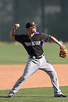 Dean Espy #52 of the Colorado Rockies during a Minor League Spring Training Game against the San Francisco Giants at the Colorado Rockies Spring Training Complex on March 18, 2014 in Scottsdale, Arizona. (Larry Goren/Four Seam Images)