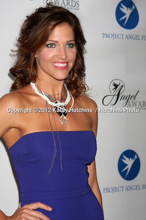 LOS ANGELES - AUG 18:  Tricia Helfer arrives at the 17th Annual Angel Awards at Project Angel Food on August 18, 2012 in Los Angeles, CA
