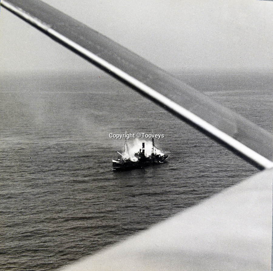 BNPS.co.uk (01202 558833)<br /> Pic:  Tooveys/BNPS<br /> <br /> Taken on 30/07/41 - A direct hit during an attack on an enemy merchant vessel.<br /> <br /> Dramatic photos showing a series of heart-pounding World War Two bombing raids from the pilot's perspective have come to light.<br /> <br /> They were taken from Blenheim bombers undertaking attacks on targets in Germany and Nazi-occupied Netherlands in 1941.<br /> <br /> Several capture the immediate aftermath of a direct hit, with flames and clouds of smoke signifying they had achieved their aim.<br /> <br /> The album, which contains almost 100 photos, has emerged for sale with Toovey's Auctions, of Washington, west Sussex.