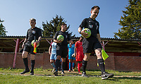Referee Nathan Briggs and officials lead the teams out  during the UHLSport Hellenic Premier League match between Flackwell Heath v Tuffley Rovers at Wilks Park, Flackwell Heath, England on 20 April 2019. Photo by Andy Rowland.