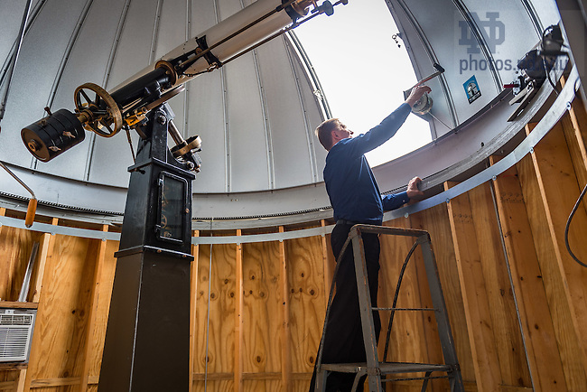 Aug. 28, 2015; Prof. Peter Garnavich opens the hatch of the Nieuwland Science Hall observatory. (Photo by Matt Cashore/University of Notre Dame)