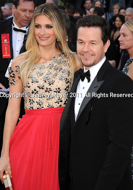 HOLLYWOOD, CA - FEBRUARY 27: Mark Wahlberg (R) and wife Rhea Durham arrive at the 83rd Annual Academy Awards held at the Kodak Theatre on February 27, 2011 in Hollywood, California.