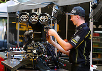 Aug. 3, 2014; Kent, WA, USA; A crew member works on the blower and injector scoop on the engine for NHRA top fuel dragster driver Richie Crampton during the Northwest Nationals at Pacific Raceways. Mandatory Credit: Mark J. Rebilas-Sports