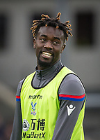 Substitute Pape N'Diaye Souare of Crystal Palace warms up at half time during the Premier League match between Crystal Palace and Manchester City at Selhurst Park, London, England on 31 December 2017. Photo by Andy Rowland.