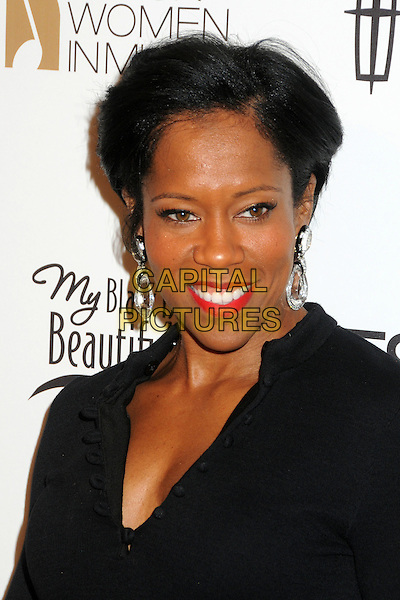 Regina King.3rd Annual Essence Black Women In Music Event held at the Belasco Theatre, Los Angeles, California, USA..February 8th, 2012.headshot portrait black red lipstick dangling silver earrings .CAP/ADM/BP.©Byron Purvis/AdMedia/Capital Pictures.