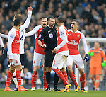 Arsenal's players surround referee Michael Oliver<br /> <br /> - English Premier League - Tottenham Hotspur vs Arsenal  - White Hart Lane - London - England - 5th March 2016 - Pic David Klein/Sportimage