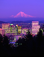 USA, Oregon, Portland skyline & Mt. Hood in alpenglow viewed from Washington Park in the West Hills of Portland.